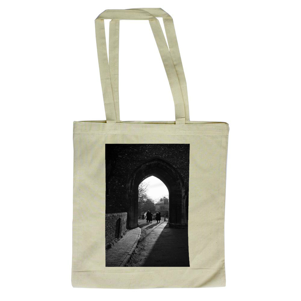 People walk through an arch near St.. Tote Bag