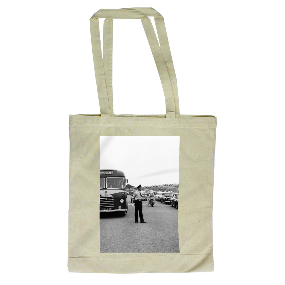 Holiday Crowds at Barry Island: Two Barry policeman control the dangerous.. Tote Bag