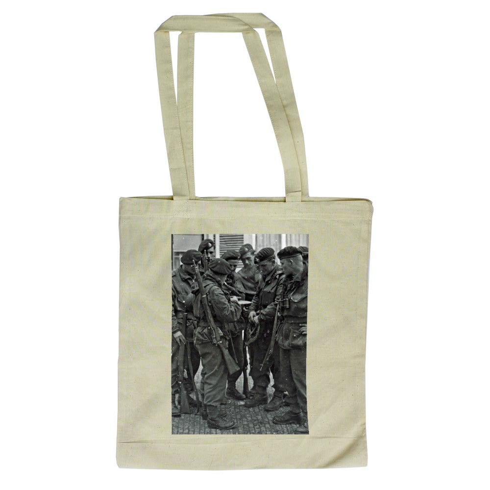 A Royal Marines NCO briefing his men before crossing the River Maas,.. Tote Bag