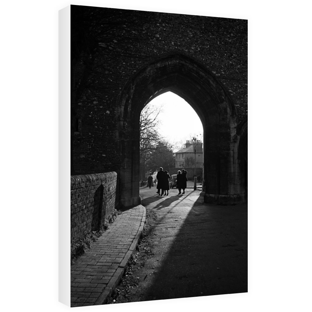 People walk through an arch near St.. Canvas