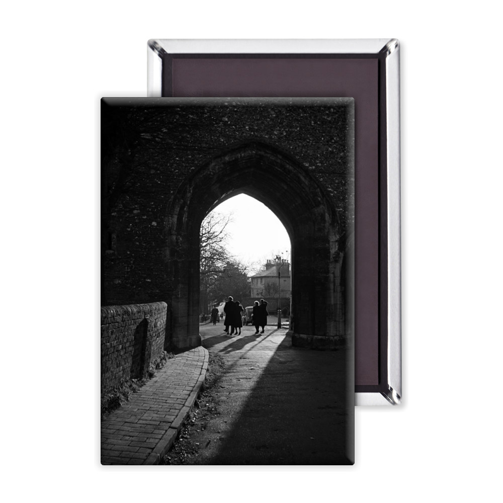 People walk through an arch near St.. Magnet