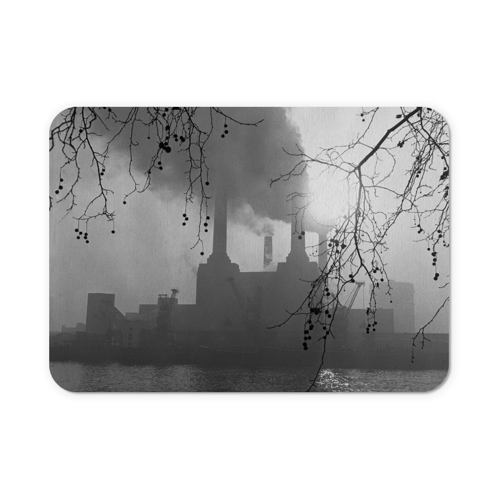 Battersea Power Station seen here on a murky foggy winters morning. London Mousemat