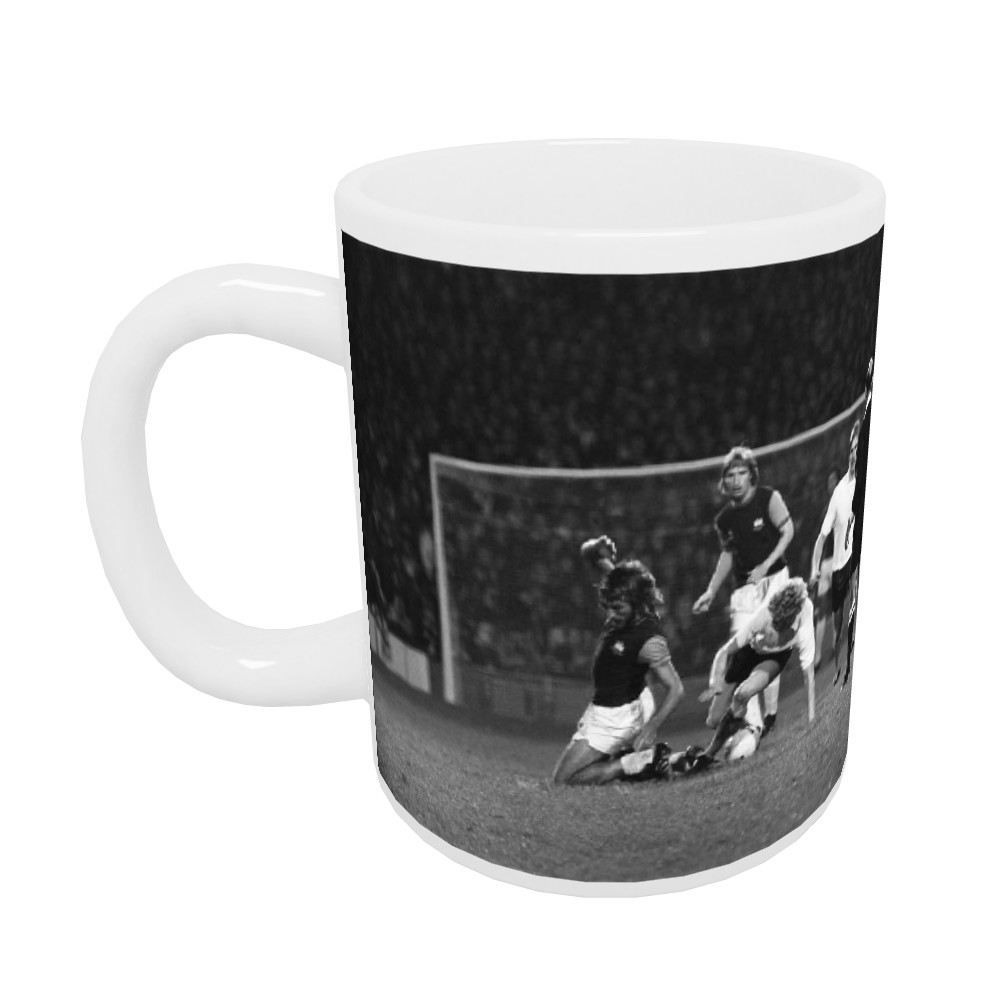 European Cup Winners Cup. West Ham v Reipas Lahden. Billy Bonds challenged.. Mug