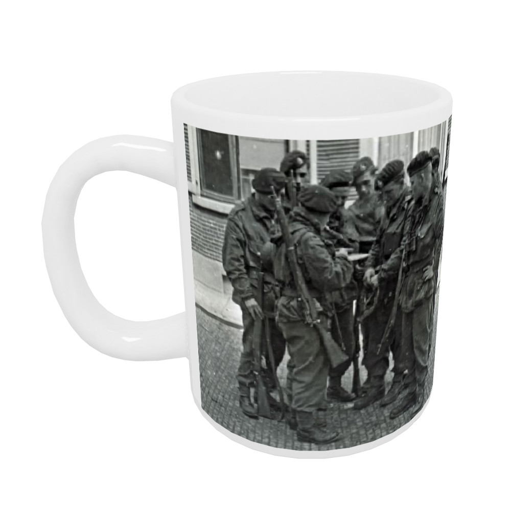 A Royal Marines NCO briefing his men before crossing the River Maas,.. Mug