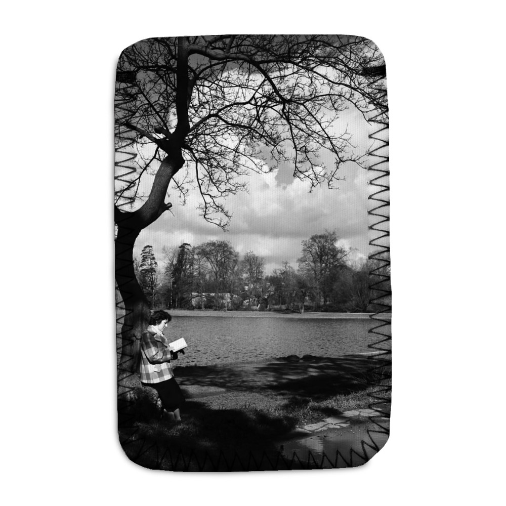 Woman reading her book by the lake in.. Phone Sock