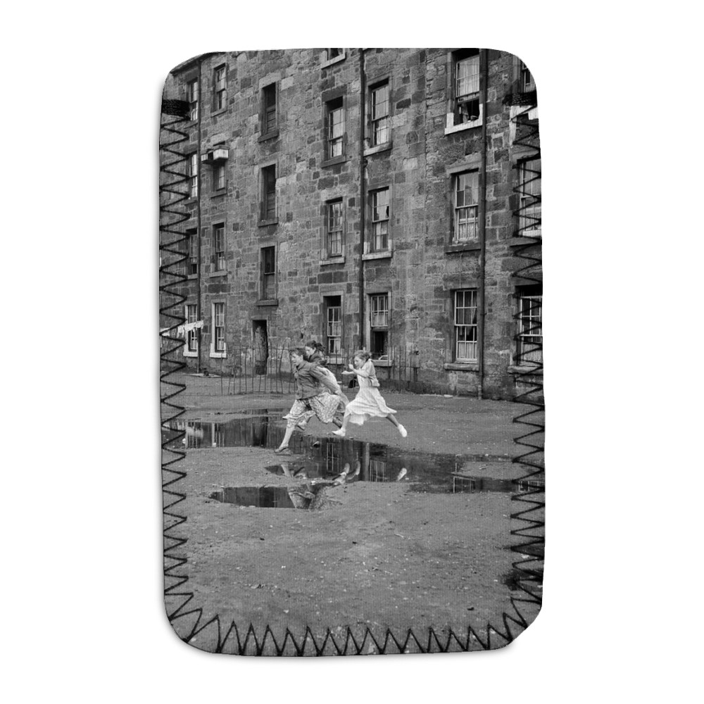 Three young friends leap over a puddle.. Phone Sock