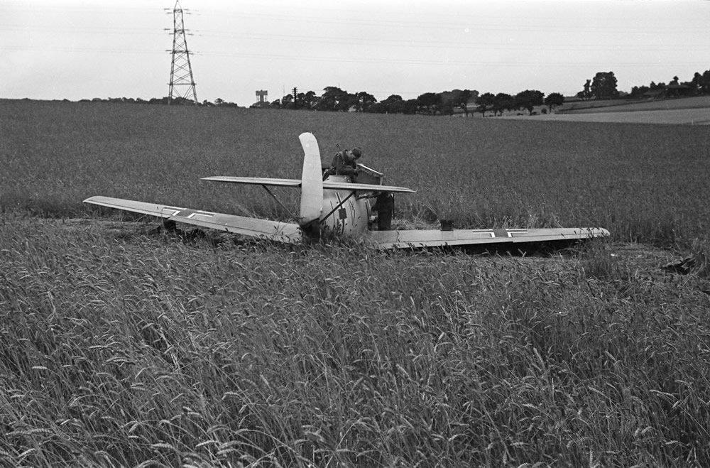 Members of the RAF technical team examine a downed Messerschmitt BF109 Art Print
