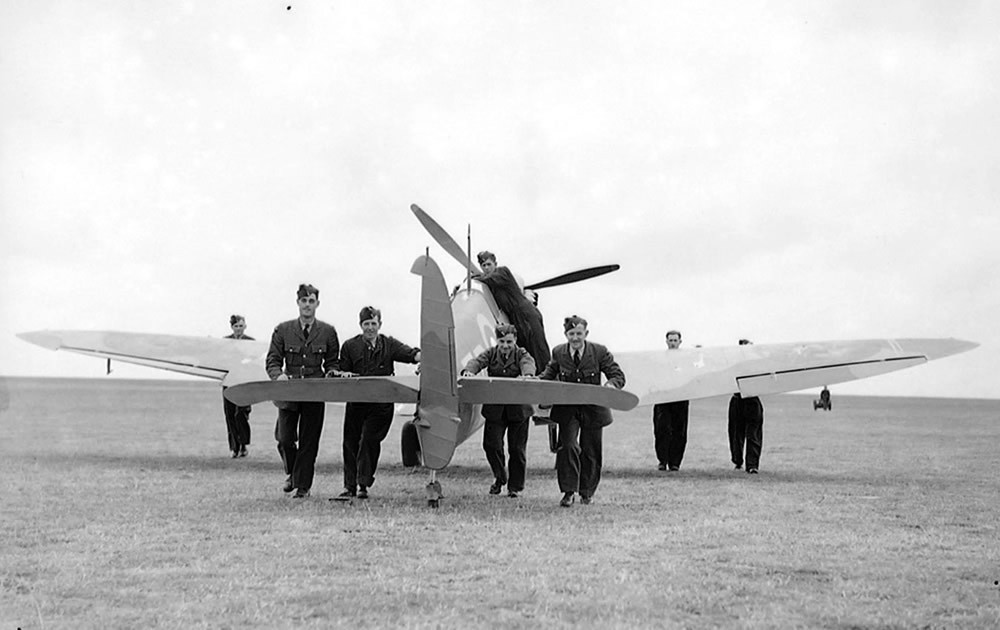 RAF ground crew push back a damage aeroplane to the hangar during the Battle of Britain Art Print