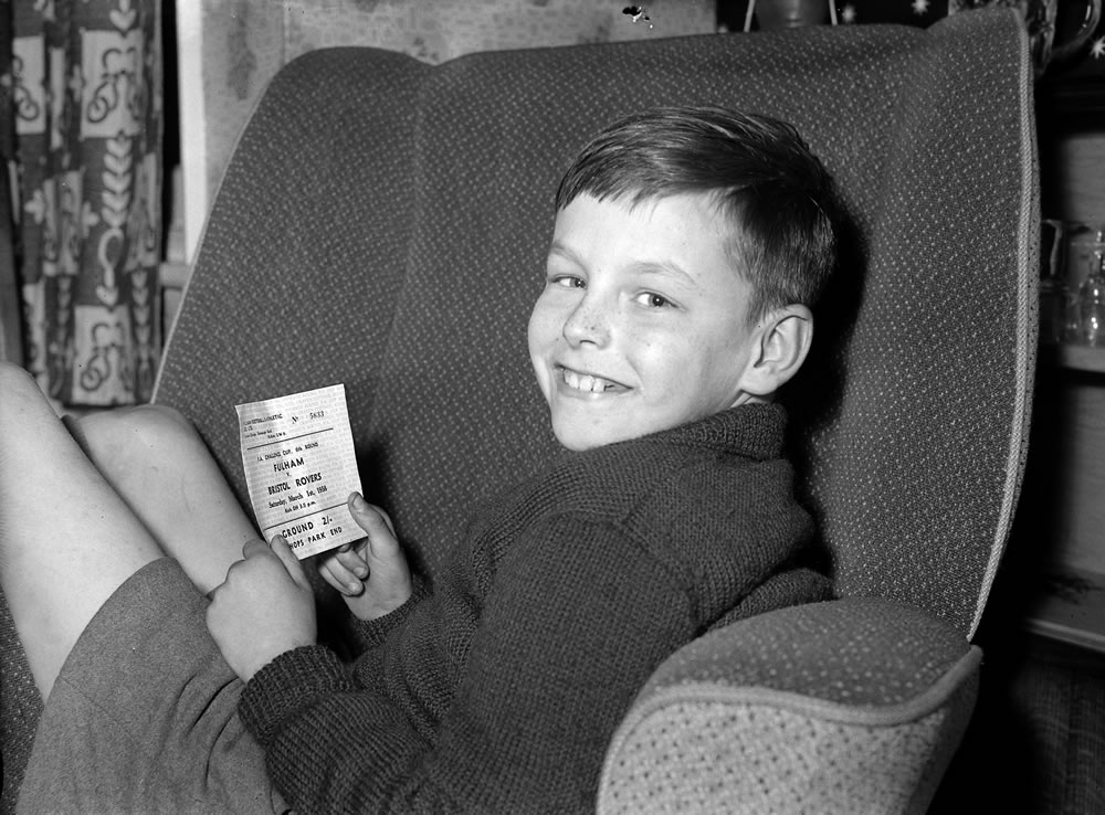 A young Fulham fan holds his ticket for.. Art Print