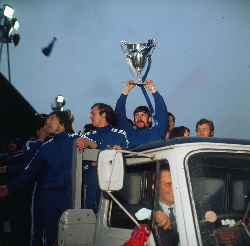 John Greig holds aloft the trophy as.. Art Print