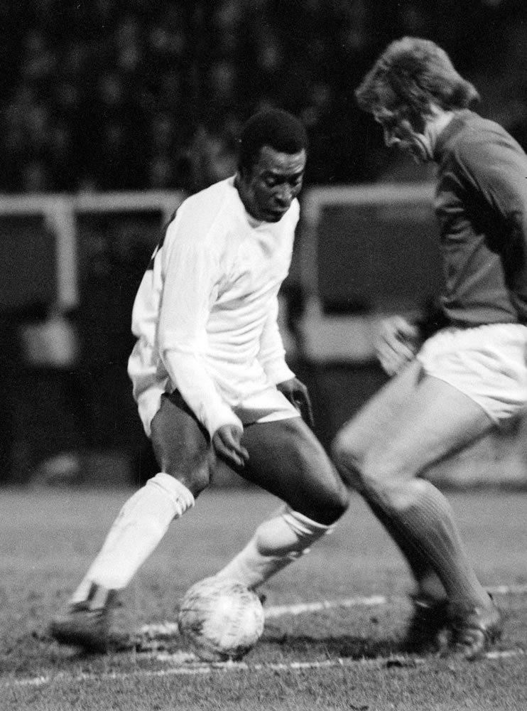 Brazilian football star Pele in action.. Art Print