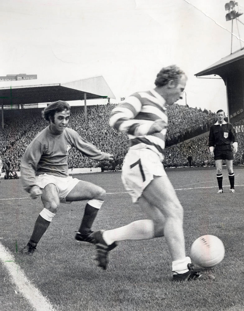 Jimmy Johnstone of Celtic takes on.. Art Print