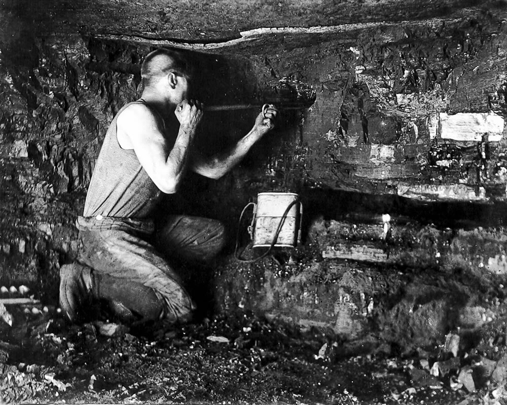 A miner working the coal face circa.. Art Print