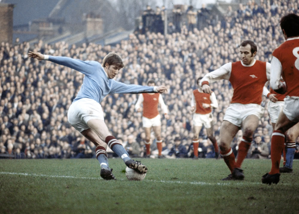 Colin Bell in action for Manchester.. Art Print