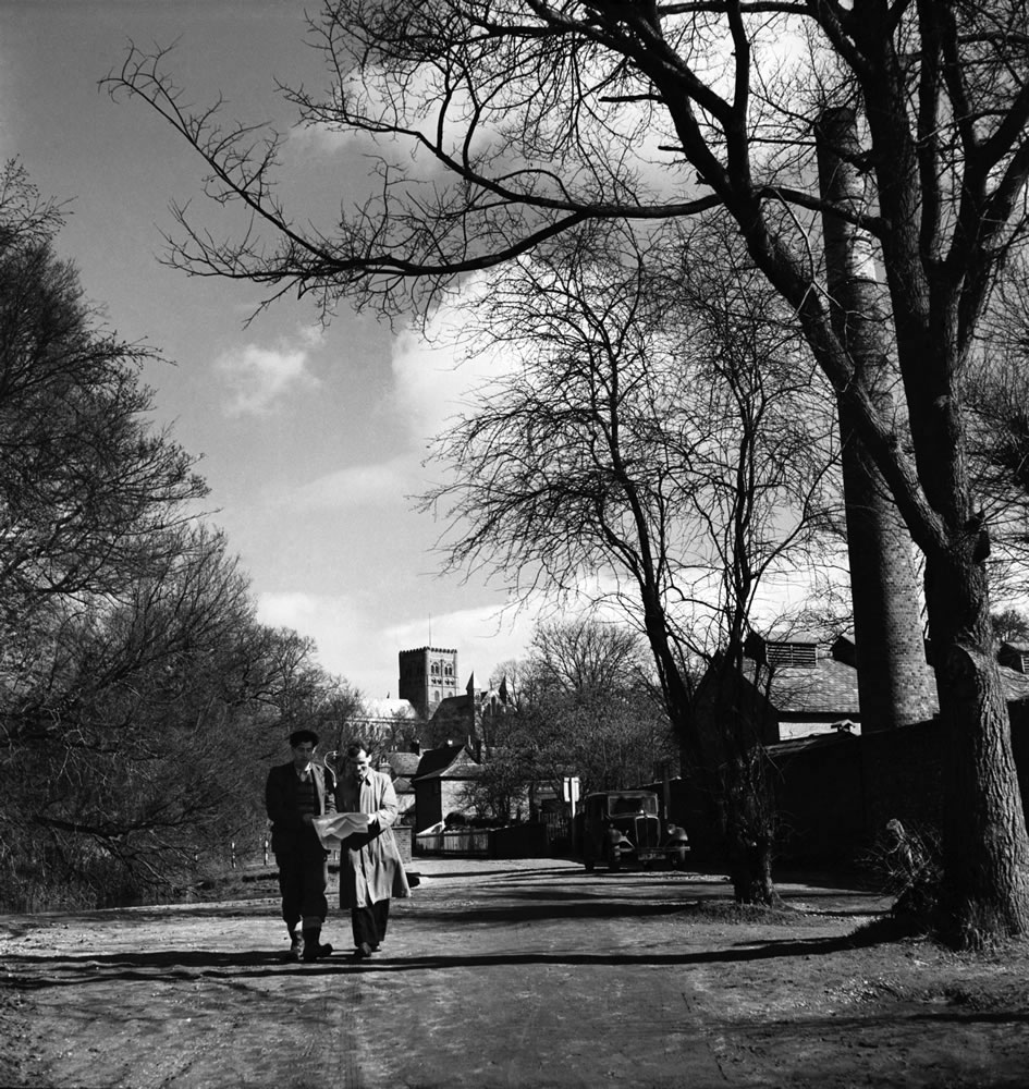 Two men walking through the park in St... Art Print