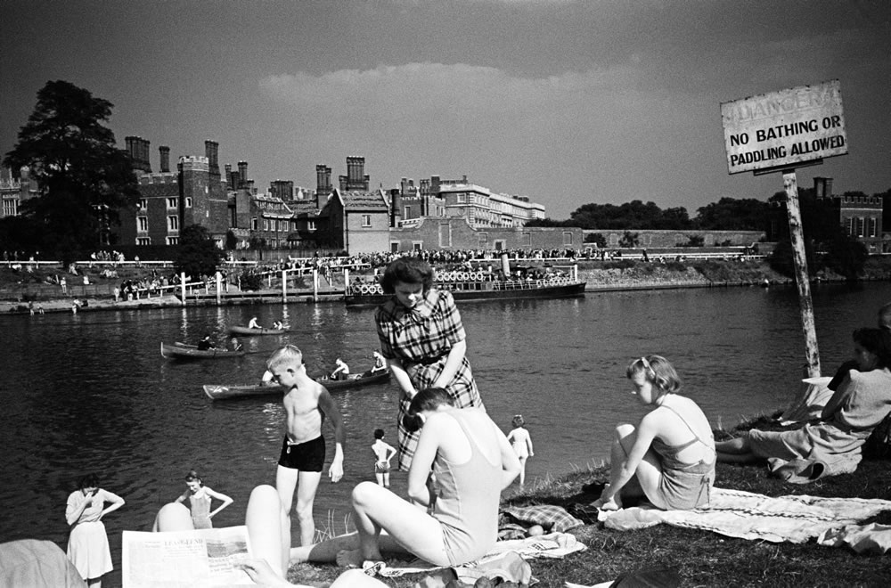 People enjoy the sunny weather at.. Art Print