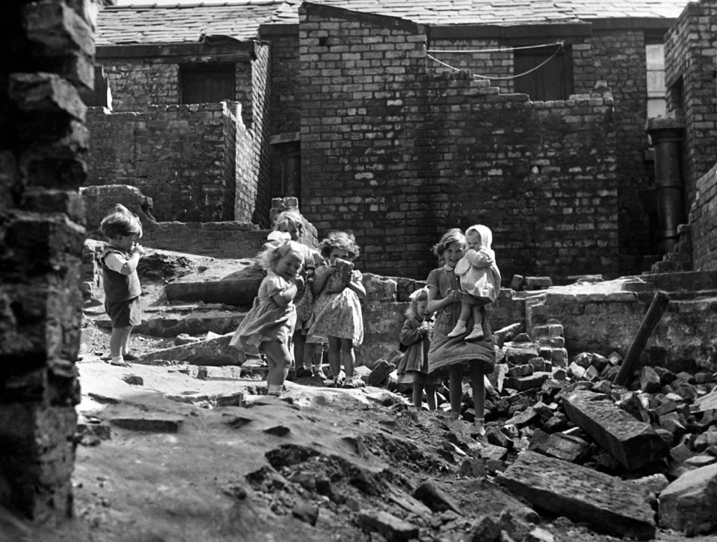 Children playing in a demolished.. Art Print