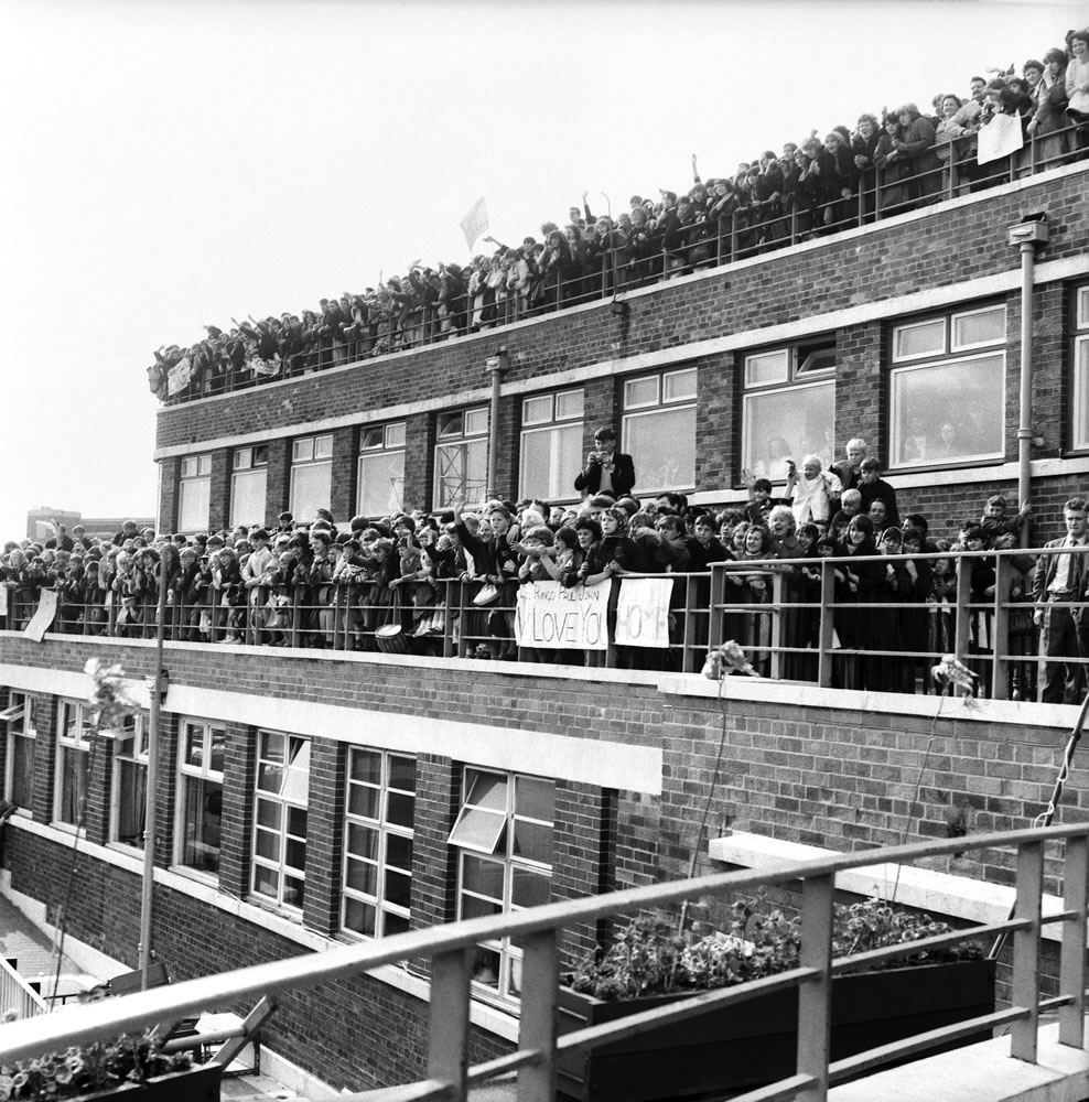Beatles fans packed onto a building.. Art Print