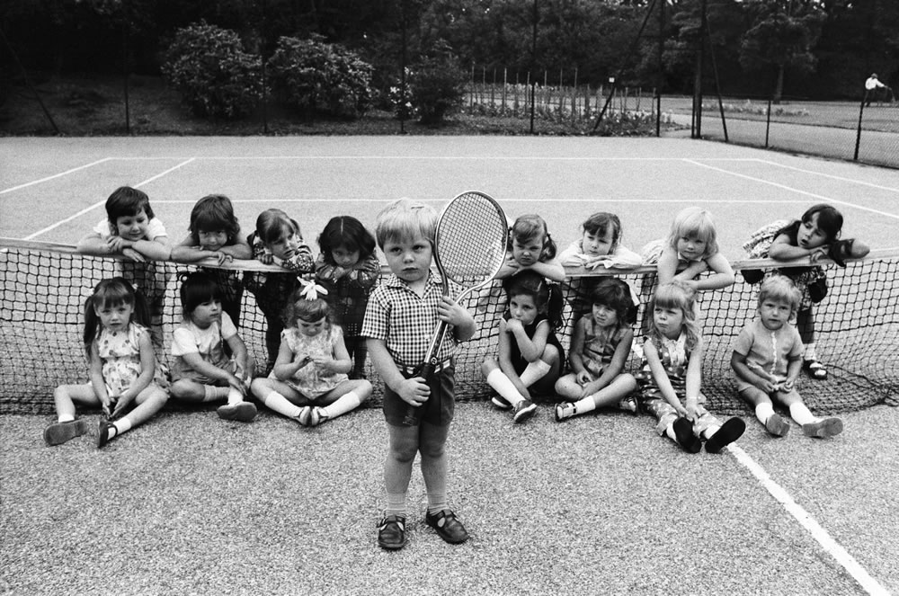 Small boy holds a tennis racket as he.. Art Print ...