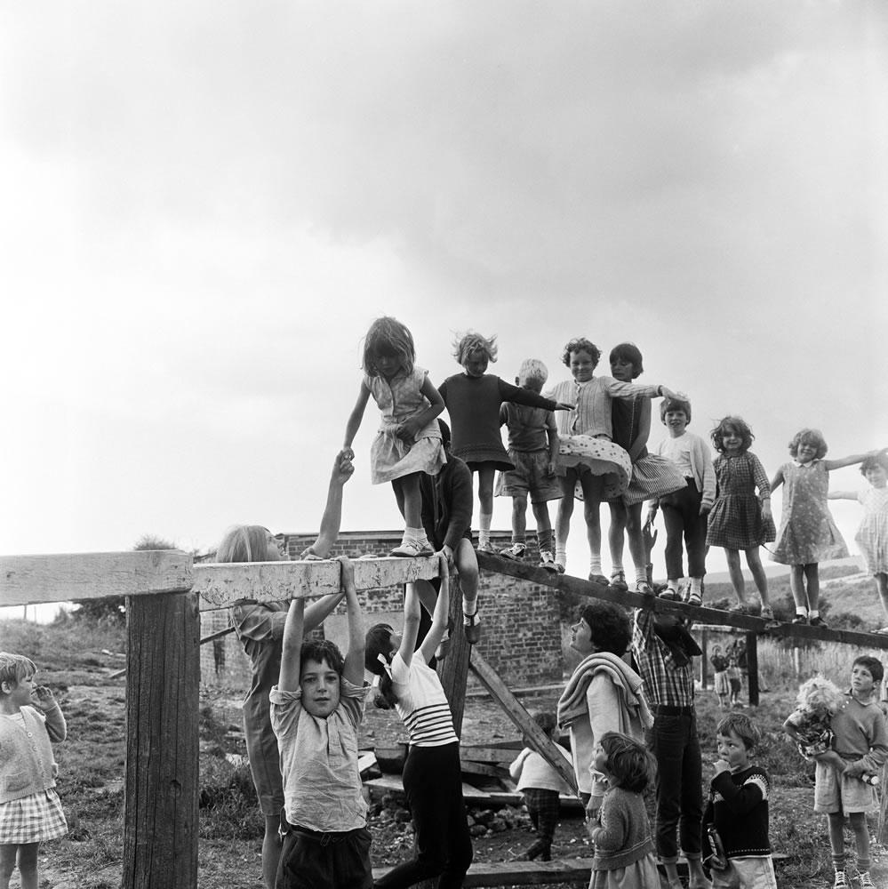 Children playing on climbing frames at.. Art Print