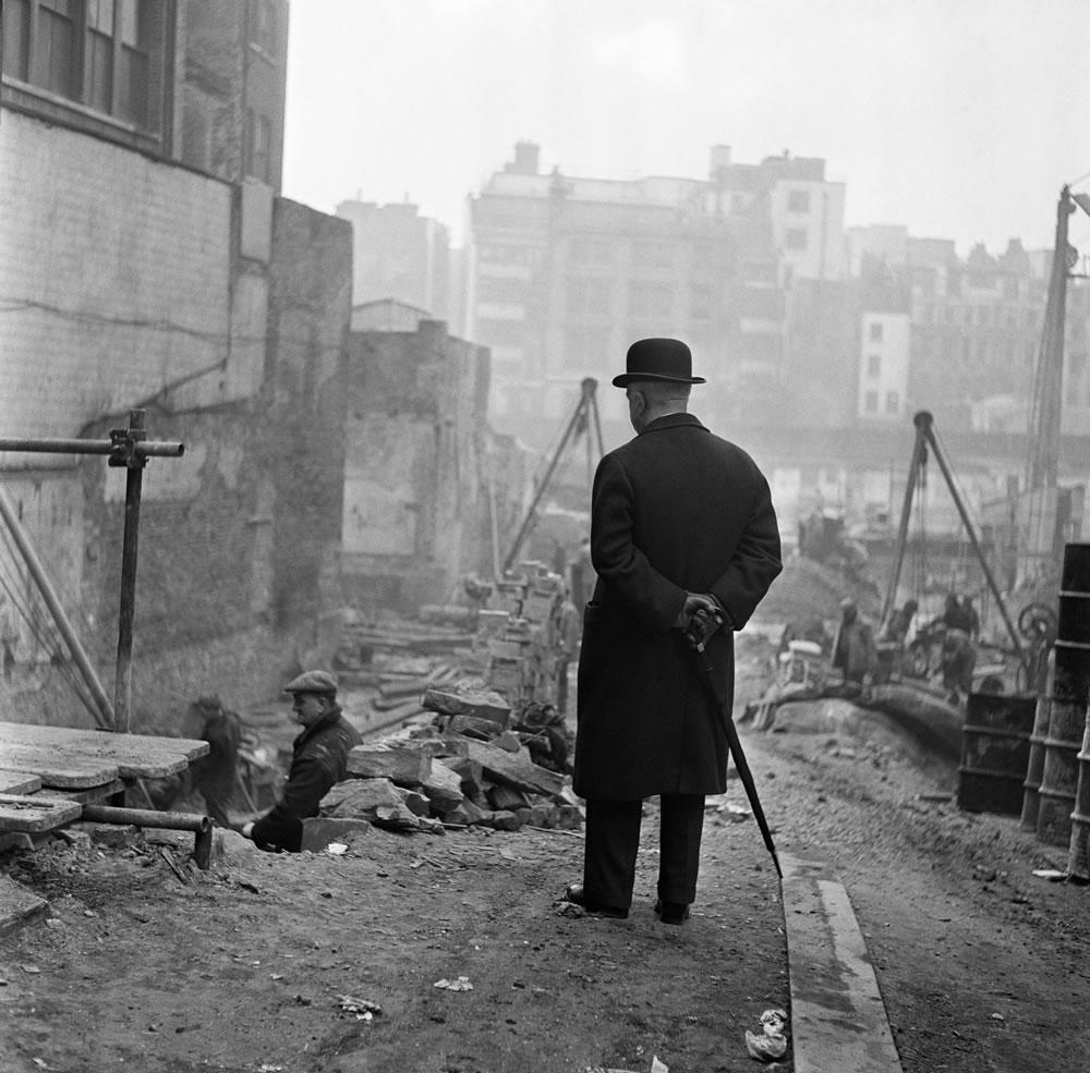 A city gent watching men working in Leadenhall Street, London. March 1954. Art Print