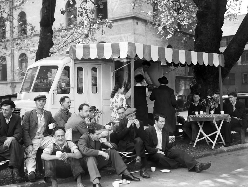 Coffee stall decorated in continental style. 22nd May 1952. Art Print