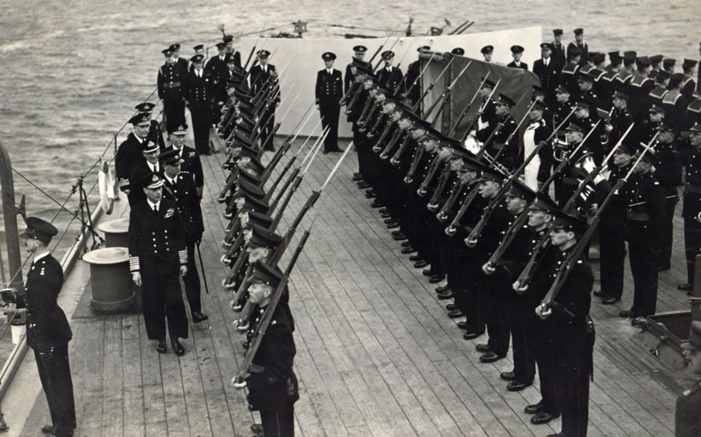 H M King George inspecting Royal Marines of the ship's RM Detachment.. Art Print