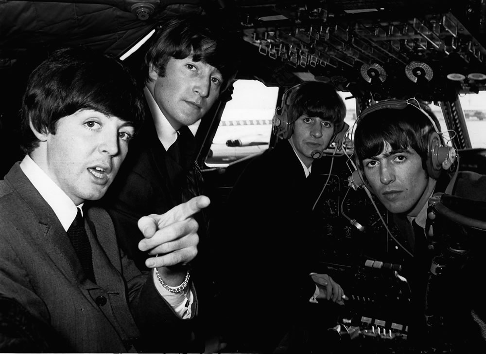 Beatles 1960s pop band in the cockpit.. Art Print