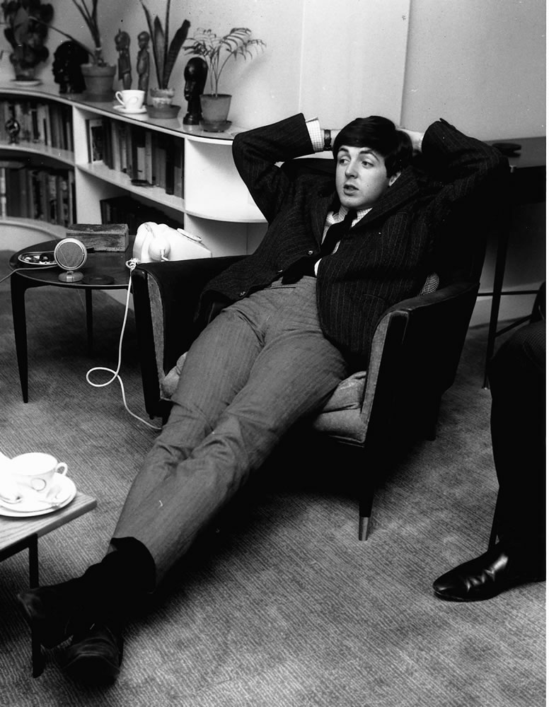 Beatles Paul McCartney lying on a chair.. Art Print