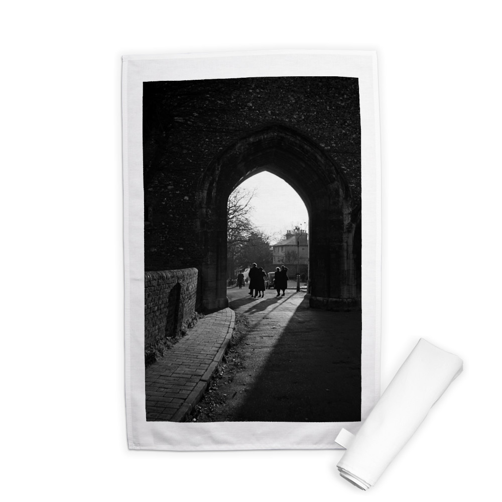 People walk through an arch near St.. Tea Towel
