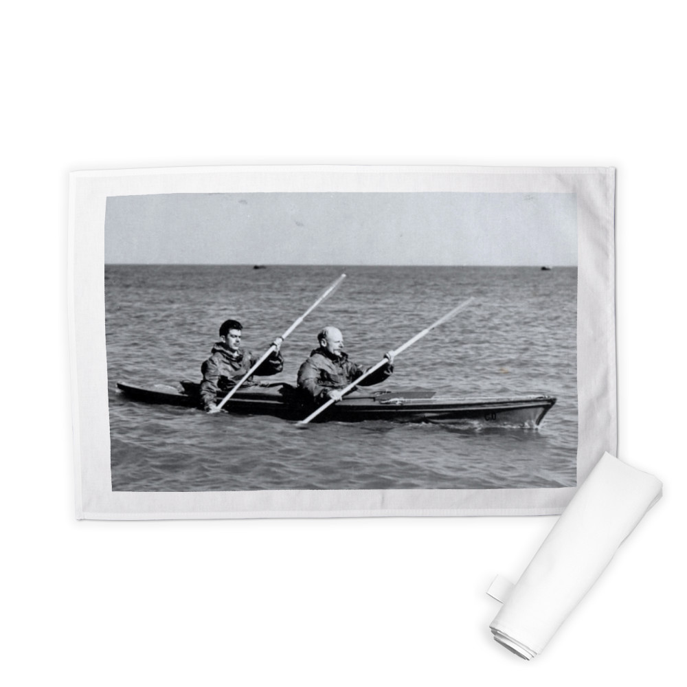 A MK2 canoe with Major Hasler & Captain Stewart showing paddling styles in.. Tea Towel